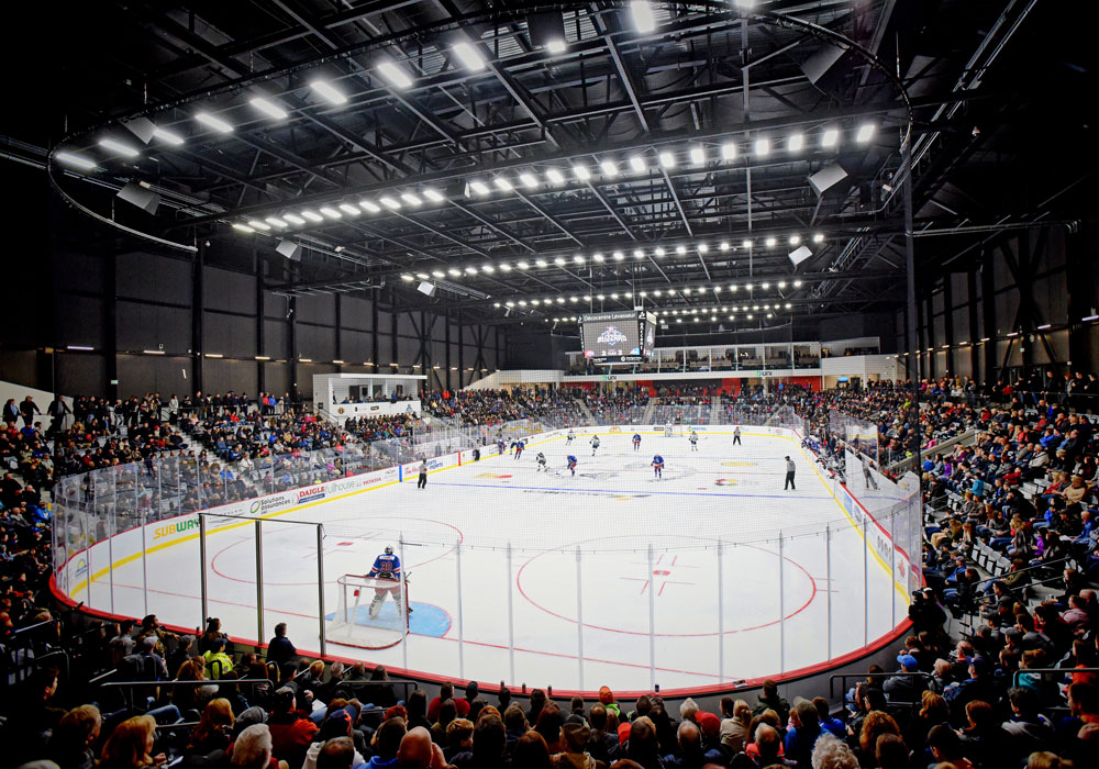 interior of the edmunston arena during a hockey game